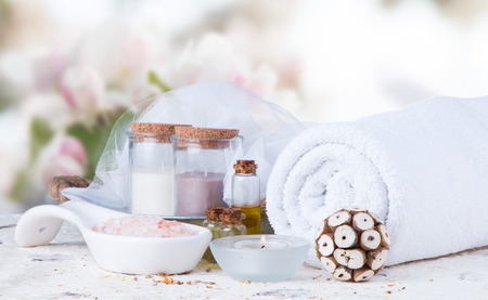 Spa concept still life with aromatic candles and flower