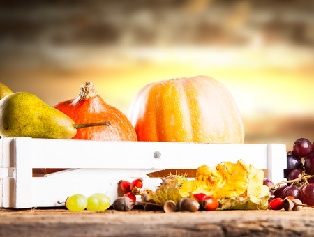 fall harvest: Autumn nature concept. Fall fruit and vegetables on wooden table