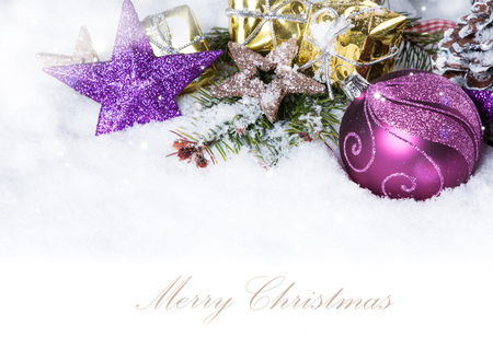 Christmas background with a purple ornament on snow, Holiday decoration
