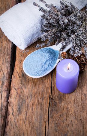 rejuvenate: massage spa setting on wooden table Stock Photo