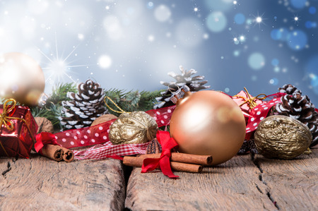 christmas greeting: Christmas decoration, ball on dark wooden background