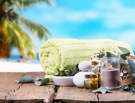 oil massage: spa concept, wellness objects on wood plant