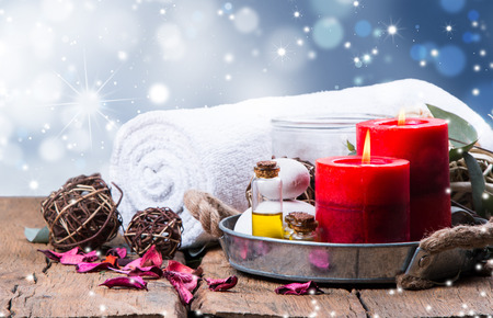 relaxation: spa concept, wellness objects on wood plant, christmas background. Present holiday concept.