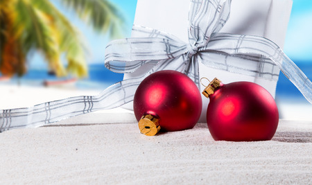decoration: Christmas ornament on a beach, concept of a warm, tropical weather Christmas Stock Photo