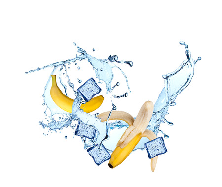 falling cubes: Fresh banana falling in water splash, isolated on white background Stock Photo