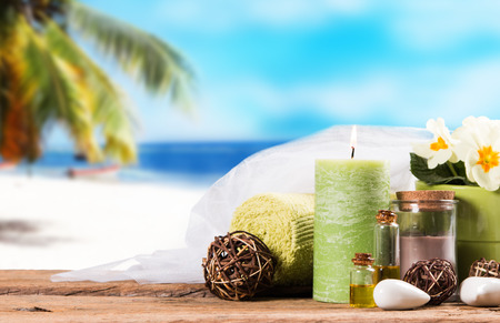 relaxation massage: Spa massage setting with tropical beach background