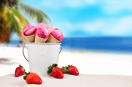 cone shell: ice cream cones in the sand on the beach Stock Photo