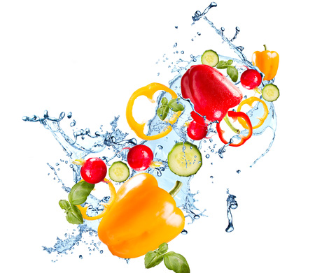 Water splash with vegetable isolated on white backgroud. Fresh pepper