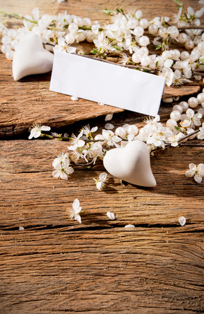 perls: flowers, heart and perls on wooden background