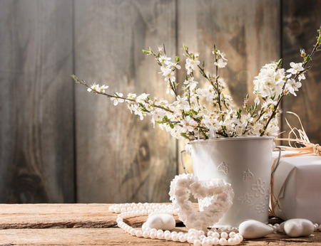 perls: Spring flowers, heart and pearls  on wooden background