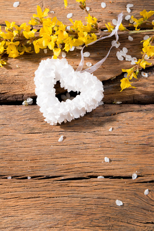 perls: Spring flower, hearts and Perls on wooden background. Holiday concept Stock Photo