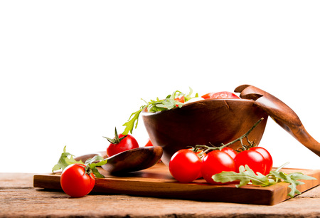 salad bowl: salad in a wooden salad bowl. Tomato, mozzarella and basil isolated on white background Stock Photo