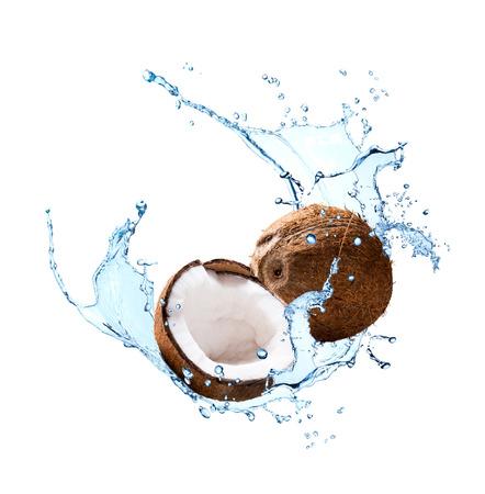 Water splash with fruits isolated on white backgroud. Fresh coconut Stock Photo