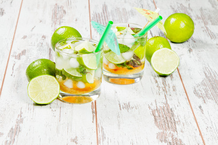 mohito: Mojito lime drinks on wooden background Stock Photo