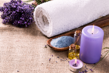 spa massage setting, lavender product, oil on wooden background Stock Photo