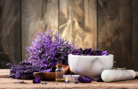 spa massage setting, lavender product, oil on wooden background Standard-Bild