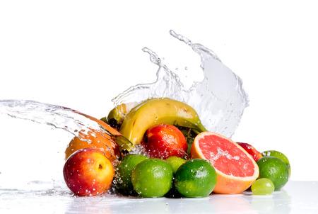 Fresh lime, grapefruit, banana, Nectarine and grape, fruits falling in water splash, isolated on white background