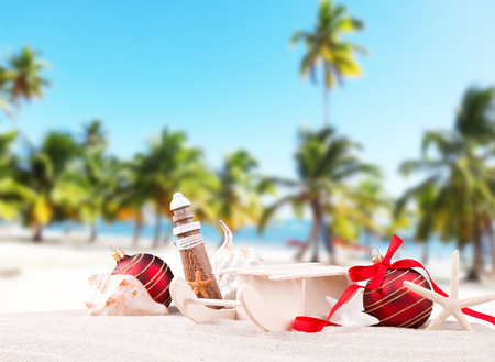 Christmas ball ornament on a beach - and the concept of warm weather Christmas