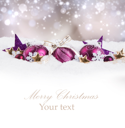 Christmas balls with decorations in snow background. Celebration object with free space for text Stock Photo