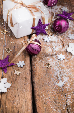 Christmas background with decorations, celebration things on wooden board Stock Photo