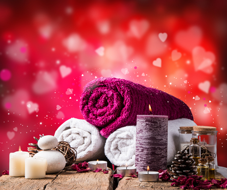 spa massage setting, lavender product, oil on wooden background, Vlaentine day background,