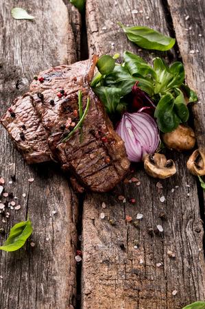 Beef steak on wood table Fresh grilled steak with vegetable