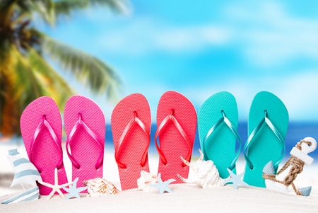 Summer concept, flip-flops, summer accessories on summer beach