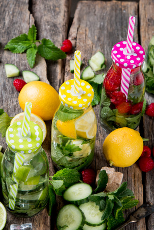 Mohito lime drinks on wooden with blur beach background. Fresh drinks with fruits on wood. Summer concept.