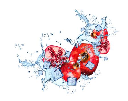 Water splash with pomegranate isolated on white background Imagens