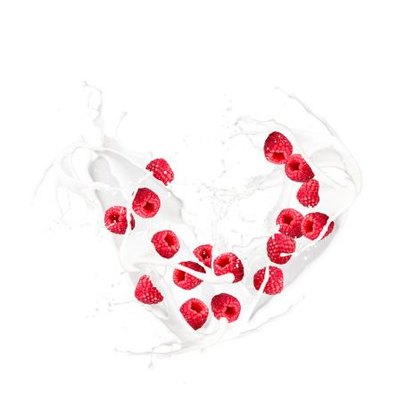 Milk splash with raspberry isolated on white