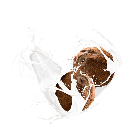 Milk splash with coconut isolated on white