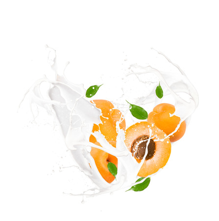 Milk splash with apricot isolated on white
