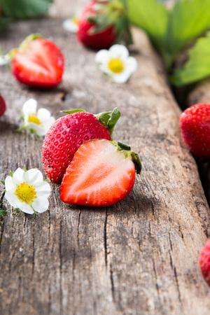 Fresh strawberries on wooden table Banco de Imagens