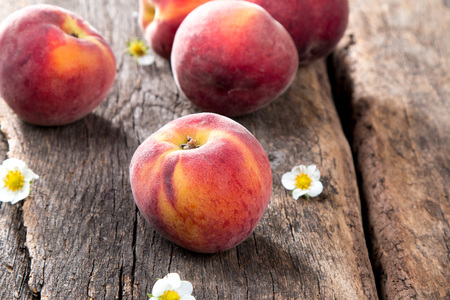 Fresh peaches on wooden table