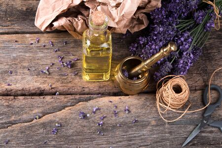 Spa massage setting, lavender product, oil on wooden