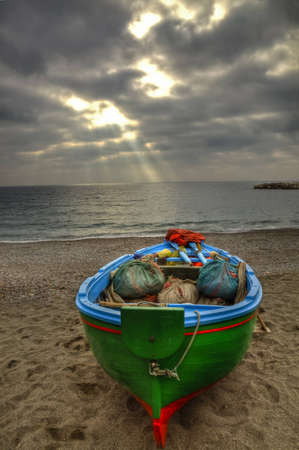 carnal: Fishing boat on the beach of Atrani (SA) during a rainstorm Stock Photo