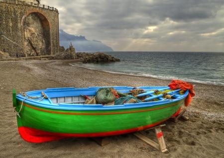 fishingnet: Fishing boat on the beach of Atrani (SA) during a temporal