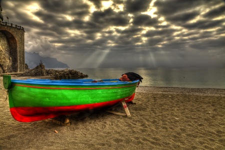 Atrani boat in beach during a strom HDR Stock Photo - 12671253