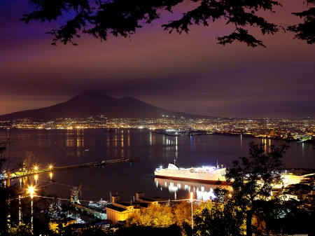 naples: Night View of Naples and Mount Vesuvius from the panoramic road Castellammare di Stabia Stock Photo