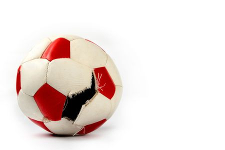 Torn soccer ball isolated on white background
