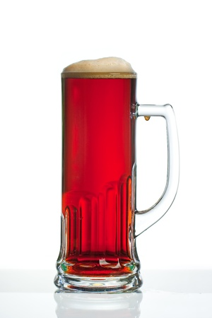 Full dark beer glass with handle against white background photo