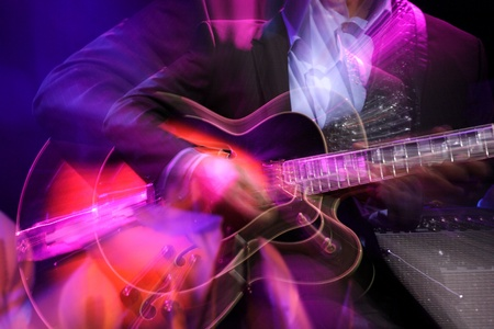 role: Abstract zoomed guitar and performer hand on stage Stock Photo