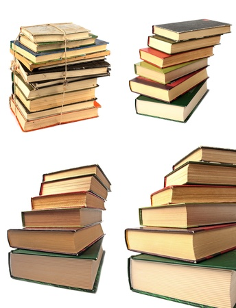 Set of stacks of different sizes of books on white background photo