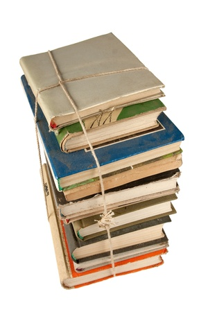 Stack of dusty  books isolated on white background Stock Photo - 11926908