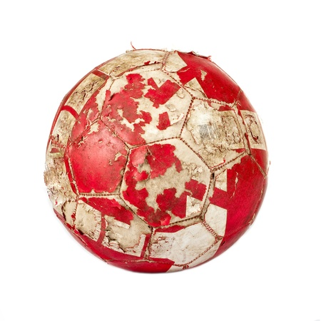 Old red soccer ball isolated on white background photo