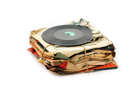 record label: Pile of old vinyl plates isolated on white background
