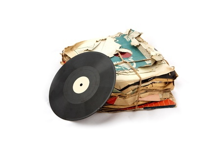 Pile of old vinyl plates isolated on white background photo