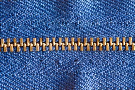 teeths: Closed blue zipper with golden teeths Stock Photo