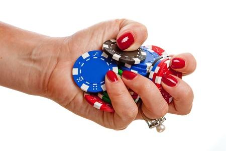 Female hand holding poker chips against white background photo
