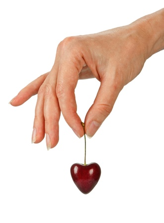 Hand holding red heard shaped cherrie against white background Stock Photo - 11926718